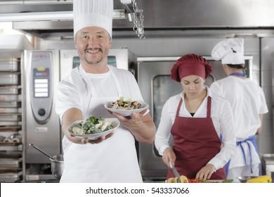 Preparing tasty gourmet pasta meal in a restaurant kitchen