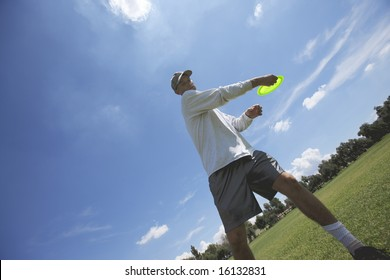 Preparing to throw a disk at a disk golf course in a park.
