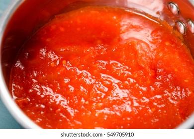 Preparing Tomato Sauce In Metal Pot