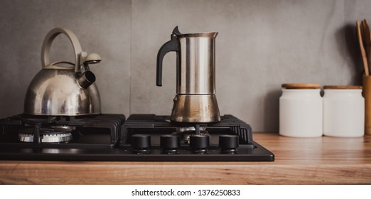 Preparing a traditional italian style coffee with coffee percolator. Making a coffe.
