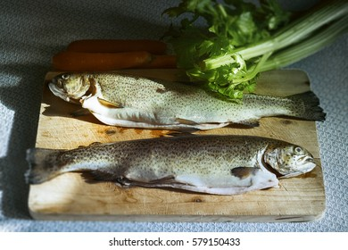 Preparing trouts. Couple of trouts is waiting for the pan.