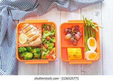 Preparing various healthy lunch boxes in orange packaging. Office lunch box. Healthy eating habits concept, flat lay composition.