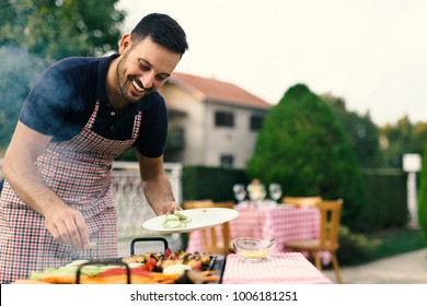 Preparing vegetables and meat on the grill