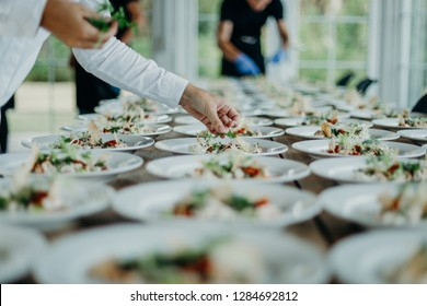 Preparing the wedding reception, catering service, hands, food