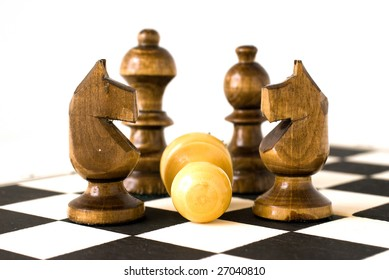 """""""Preponderance"""" Chess figures on chessboard."""