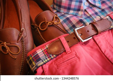 A preppy men's outfit for the summer / spring time. The matching leather shoes and belt compliment the salmon pink shorts and checkered shirt.