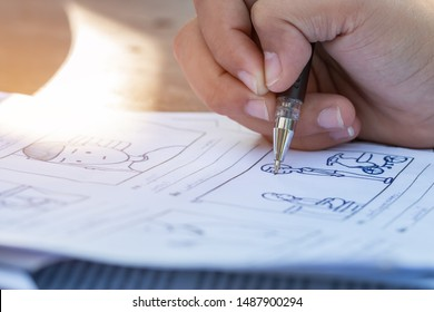 Pre-production for film movie story concept : Hands drawing storyboard animation comic carton, design creative scene layout at studio. Behind making work before production films or video shot