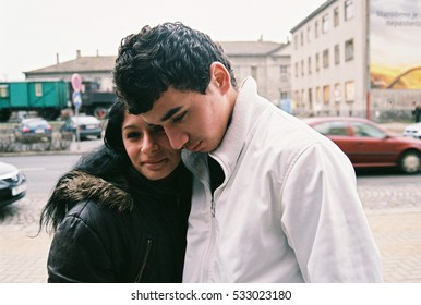 PREROV, CZECH REPUBLIC, APRIL 5, 2012: Portrait of a Gypsy young girl and boy in the ghetto street Husova,  Photographed on cine-film, photo has a characteristic color and noise, Europe