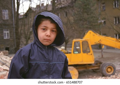 PREROV, CZECH REPUBLIC, APRIL 5, 2012: Portrait of a Gypsy poor young boy in the ghetto street poor Skodova, gypsies. Photographed on cine-film, photo has a characteristic color and noise, Europe