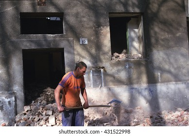 PREROV, CZECH REPUBLIC, JUNE 1, 2011: A Roma, gypsy man working in the ghetto, clean up the mess of the house, which will be demolished, Europe, EU
