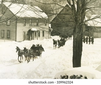 Pres. Calvin Coolidge traveling by sled to his home in Plymouth Notch, Vermont in March 1926. In the front sled, in second seat left, is John Coolidge and Atty. Gen. Sergeant; in the rear seat are the