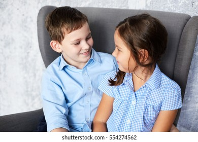 preschool boy and girl looking at each other