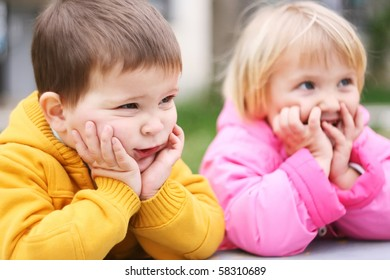 Preschool boy and girl looks ridiculous