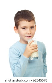 Preschool boy holding a glass with milk isolated on white background