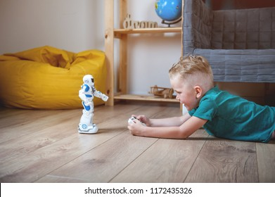Preschool  boy playing with toy robot at home or daycare. Toys for preschool and kindergarten.  Educational toys for boy and girl. Educational lessons and programming