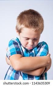 Preschool caucasian boy makes fake sad face