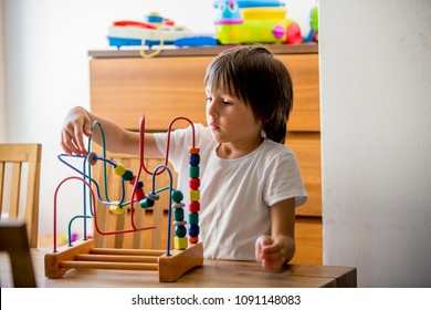 Preschool child, playing with toys in a sunny room, child development
