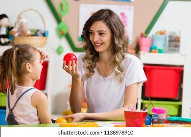 Preschool Child and Teacher in Classroom