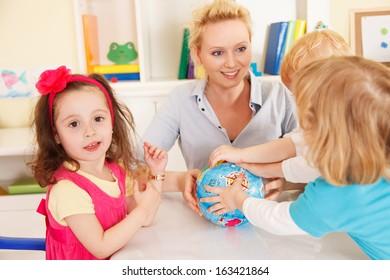 Pre-school children in the classroom with the teacher