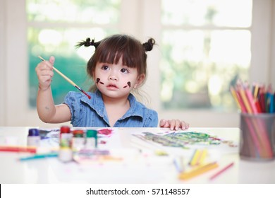 Preschool children cute little girl painting and drawing