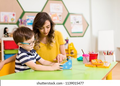 Preschool Children and Teacher in Classroom