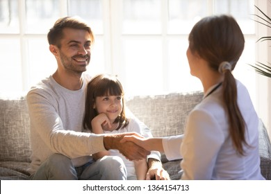 Preschool daughter with father having visit paediatrics parent and doctor woman shaking hands greeting each other. Concept of pediatrics medicine care of children, medical insurance health examination
