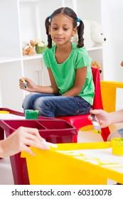 preschool girl in classroom