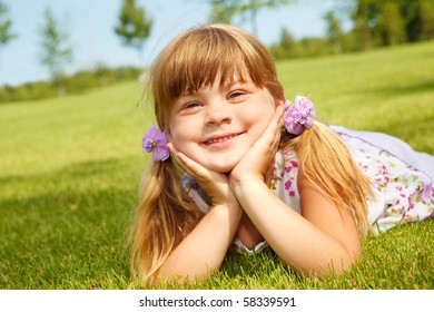 Preschool girl on grass
