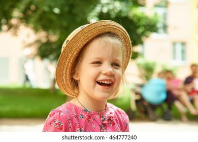 Preschool girl in straw hat