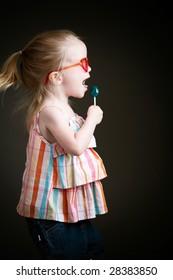 preschool girl with sucker