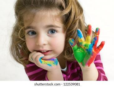 Preschool girl waving hello/goodbye with her hands painted