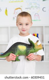 preschool kid playing with dinosaur