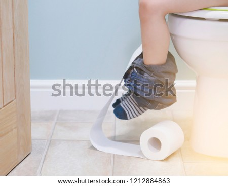Preschool toilet Kid Preschool Kid Sitting On Toilet And Playing With Toilet Rollslow View Of Kid Legs Red Ted Art Preschool Kid Sitting On Toilet Playing Stock Photo edit Now