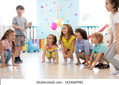 Preschool kids boys and girls squat playing in daycare or kindergarten