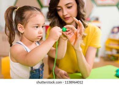 Preschool Student and Teacher
