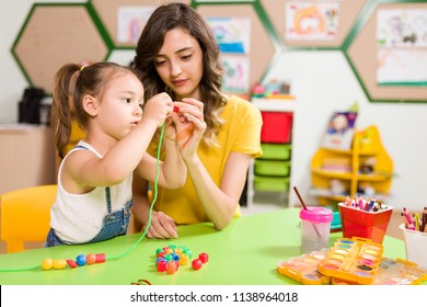 Preschool Student and Teacher