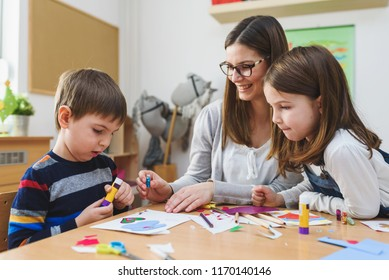 Preschool Teacher with Children at Kindergarten - Creative Art Class