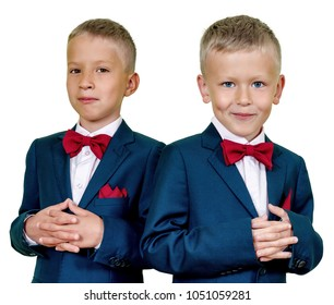 Preschool twins in formal suits portrait isolated
