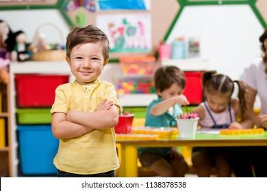 Preschooler in clssroom.