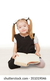Preschooler girl reading a book. Isolated on white background.