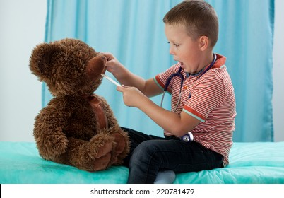 Preschooler and his teddy bear at pediatrician