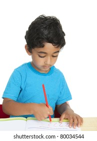 Preschooler Practicing Writing Numbers in a Workbook, Isolated, White