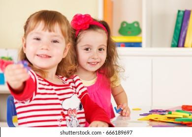 Preschoolers in the classroom working together