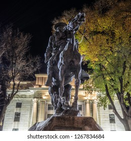 Prescott, Arizona – November 2, 2018: Historic Rough Rider statue at the Yavapai County Courthouse in Prescott Arizona photographed at night.