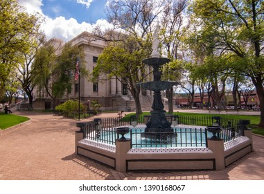 Prescott, Arizona, USA 04/22/2019 The fountain in the Yavapai County Square with the courthouse in the background on a sunny spring day