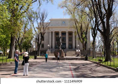 Prescott, Arizona, USA 4-25-2018 The Yavapai County Courthouse with a bronze statue of Bucky O'Neil on the walkway to the steps. O'Neil was a former mayor of Prescott and an original Rough Rider