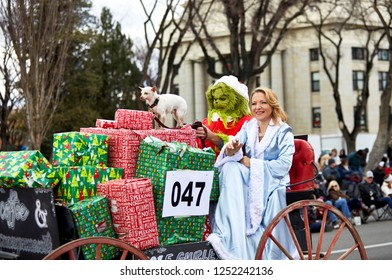 Prescott, Arizona, USA - December 1, 2018:  Grinch on a Christmas Float in the Christmas Parade on Cortez St.