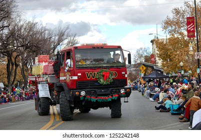 Prescott, Arizona, USA - December 1, 2018: Williamson Valley firetruck decorated with Christmas decorations participating in the Christmas parade in downtown Prescott