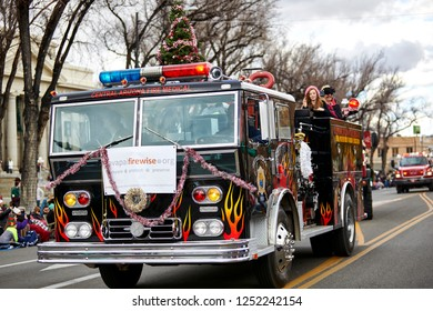 Prescott, Arizona, USA - December 1, 2018: Central Arizona firetruck decorated with Christmas decorations participating in the Christmas parade in downtown Prescott