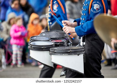 Prescott, Arizona, USA - December 1, 2018: Chino Valley High School Drummer in Marching Band at Christmas parade on Cortez St.